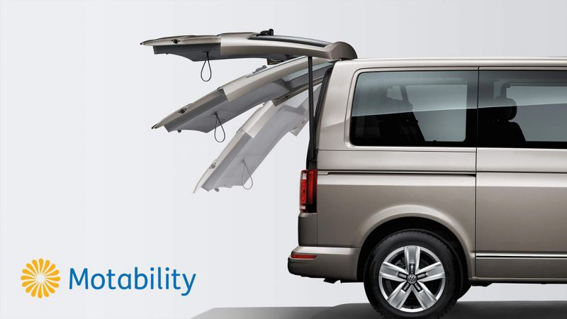 Volkswagen van with accessible rear door, with Motability logo