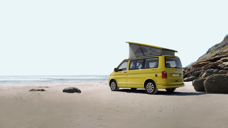 Yellow VW van on California beach