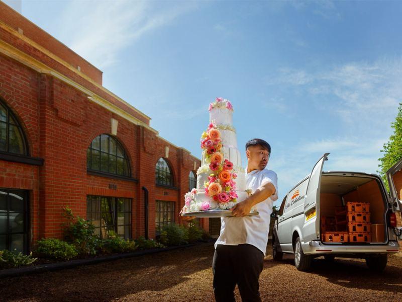 Caterer delivering a wedding cake in his Transporter