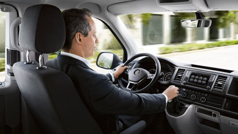 Man driving a VW interior