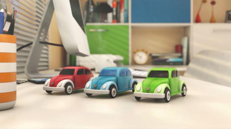 mini Volkswagen Beetles standing on a table