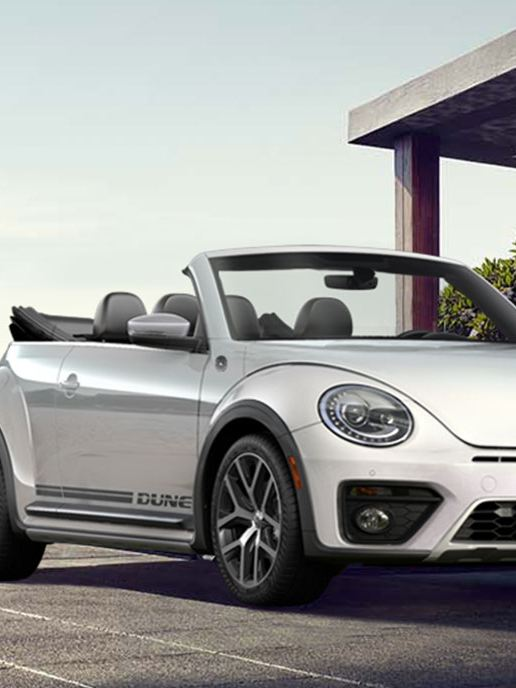 The Beetle Convertible next to a woman