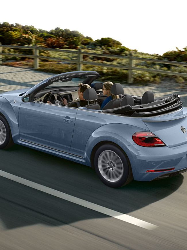 Two people enjoying a drive in the Beetle Convertible