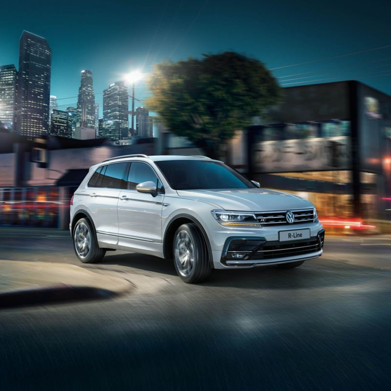 Action shot of the Volkswagen R-Line driving in the city