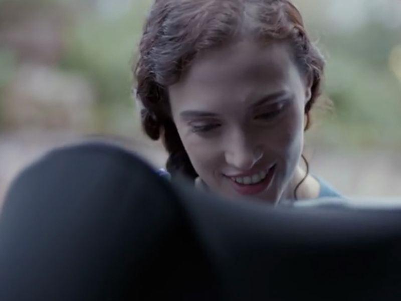 Close up of woman behind car seat