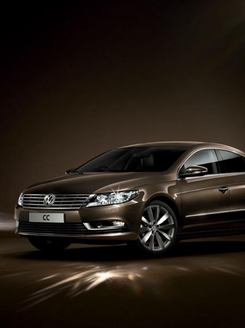 3/4 front view of a bronze Volkswagen CC.