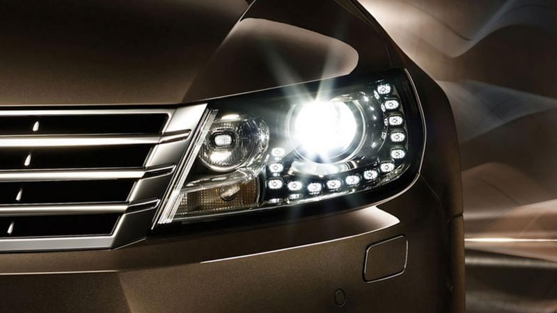 Front left headlight shot of a bronze Volkswagen CC.