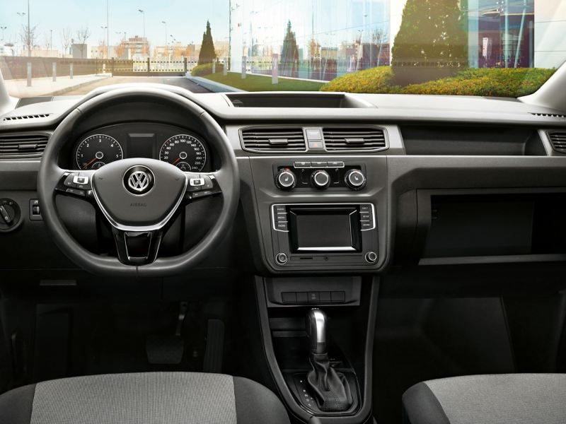 A view into the Volkswagen Caddy Panel Van cockpit with its wide array of storage options.