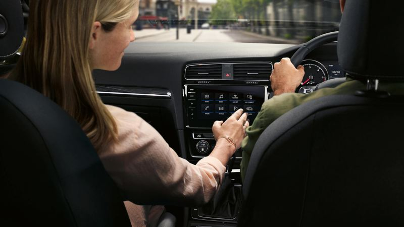 People playing with the electric screen in the car
