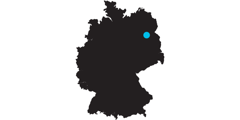 Outline of a map of Germany with a mark on the location of Berlin