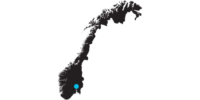Outline of a map of Norway with a mark on the location of Oslo