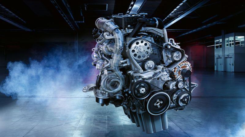 Raffigurazione di una scultura composta da motori di auto.
