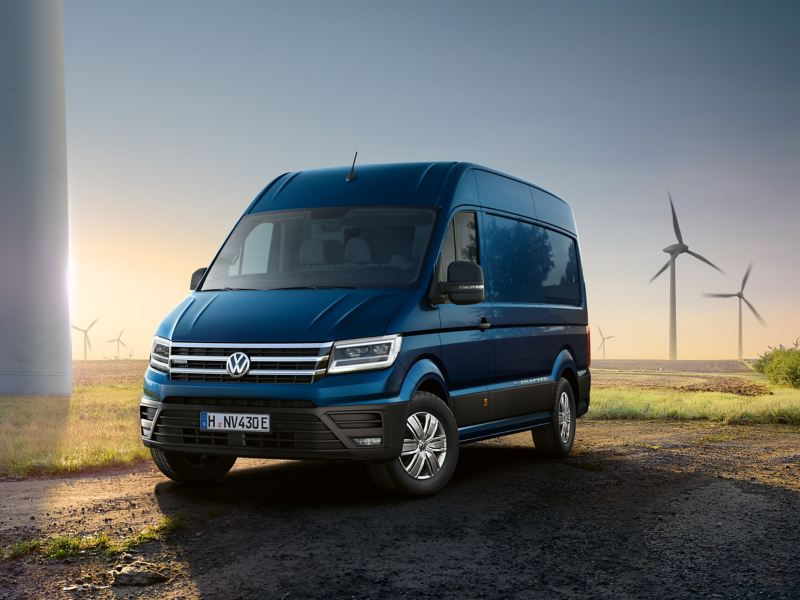 The e-Crafter stands in front of a field containing wind turbines.