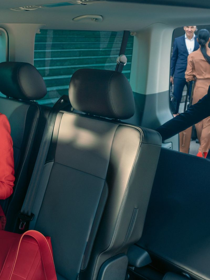 A man is changing the seat arrangements in the Caravelle 6.1.