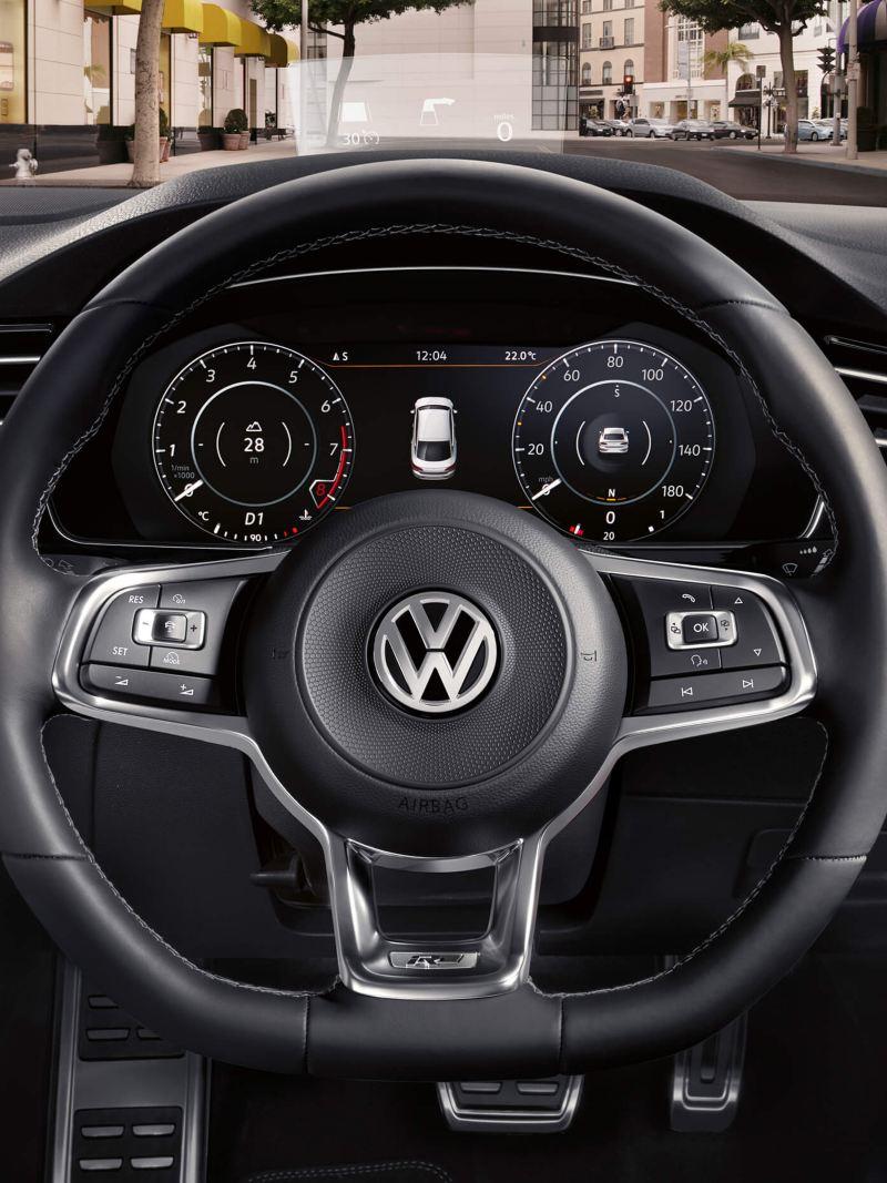 Smart windscreen of a Volkswagen, the city streets outside.