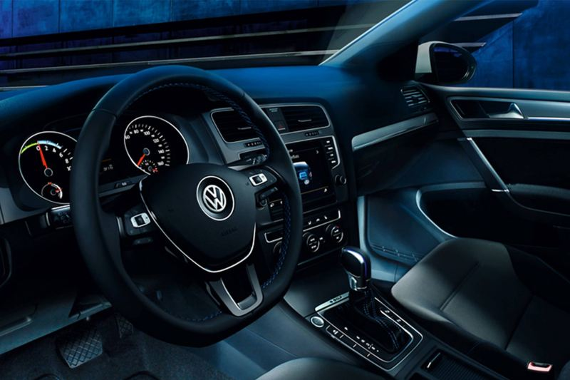 Interior shot of a Volkswagen e-Golf, steering wheel and dashboard.