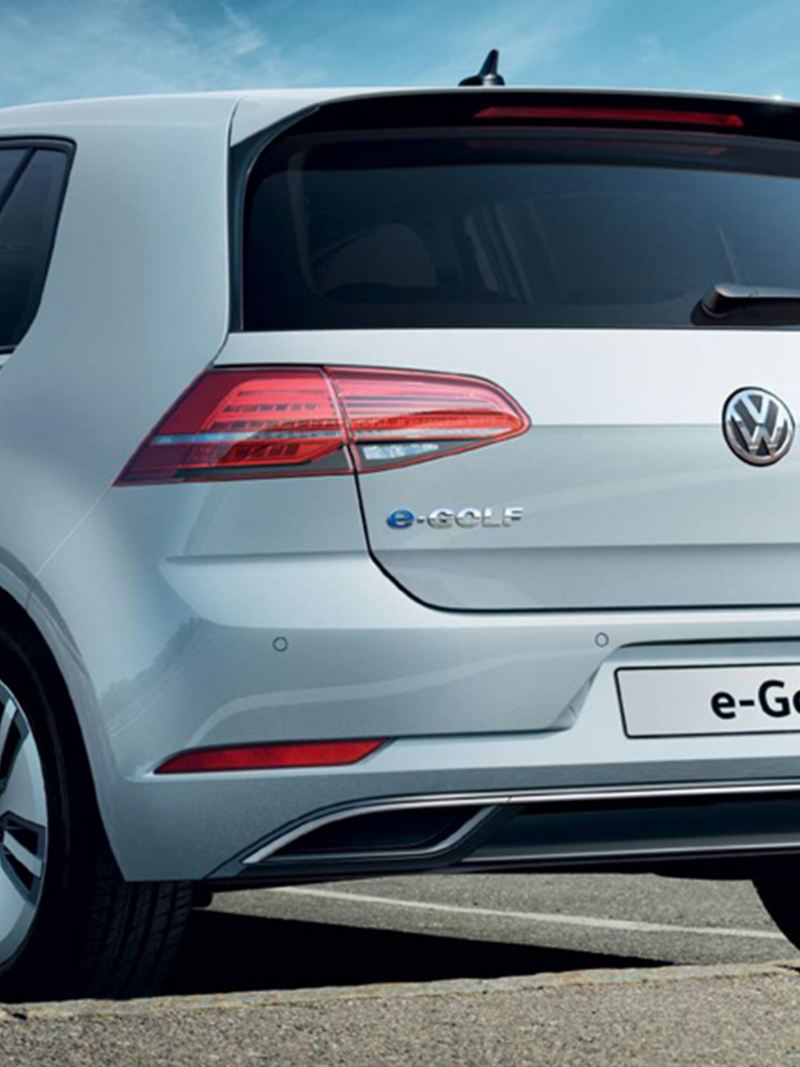 3/4 back view of a white Volkswagen e-Golf.