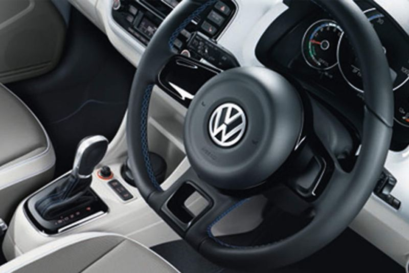 Interior shot of a Volkswagen e-up! steering wheel and dashboard.