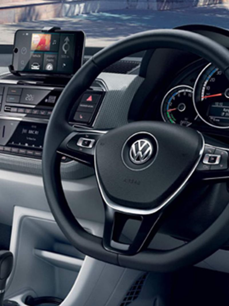 Interior shot of a Volkswagen e-up!, steering wheel and dashboard.