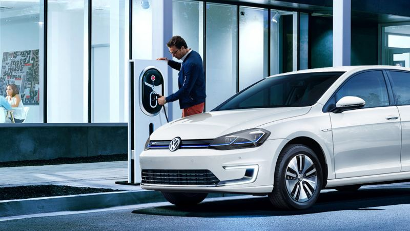 Man charging a 2020 Volkswagen e-golf