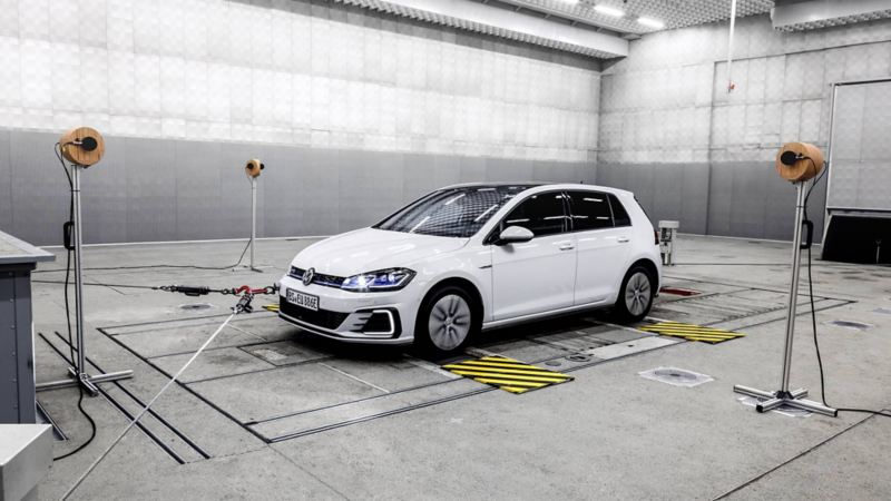 A Volkswagen Golf GTE on a dynamometer in the exterior noise hall