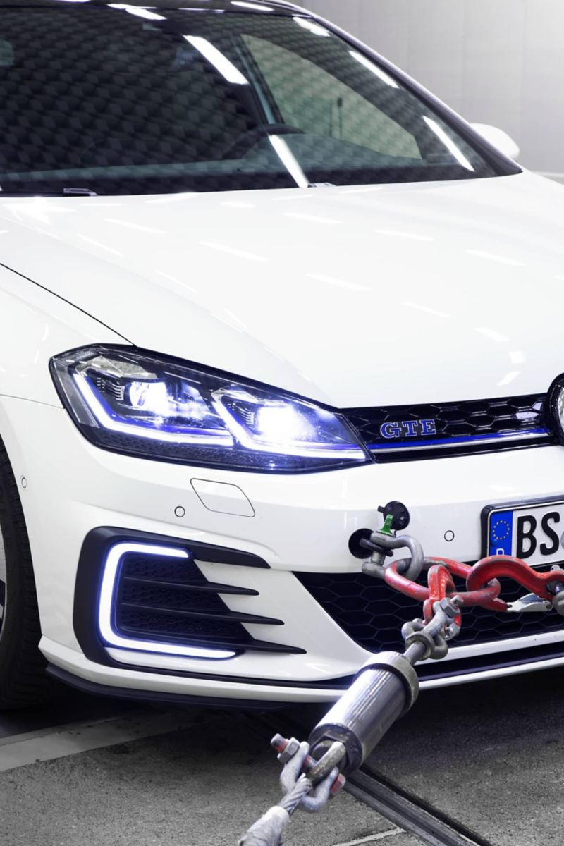 Detail view of the front of a Volkswagen Golf GTE on a dynamometer in the exterior noise hall
