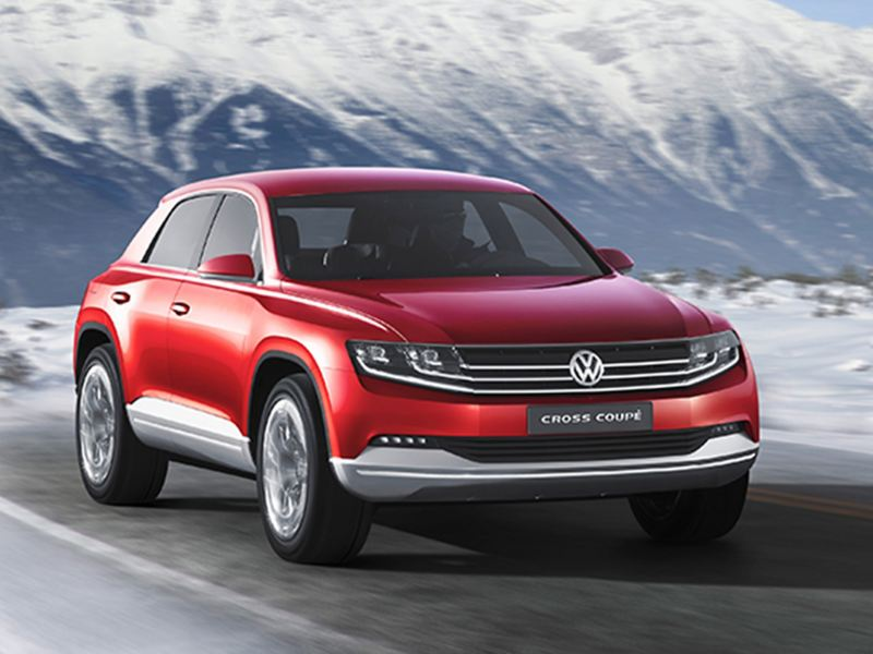 A red Volkswagen Cross Coupé concept, within a snowy mountain setting.