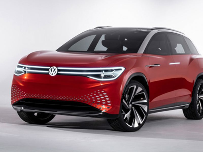 A deep red Volkswagen ID. ROOMZZ concept car.