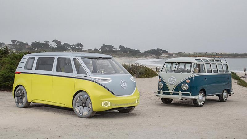 VW ID BUZZ concept vehicle and T1 camper van parked on a beach