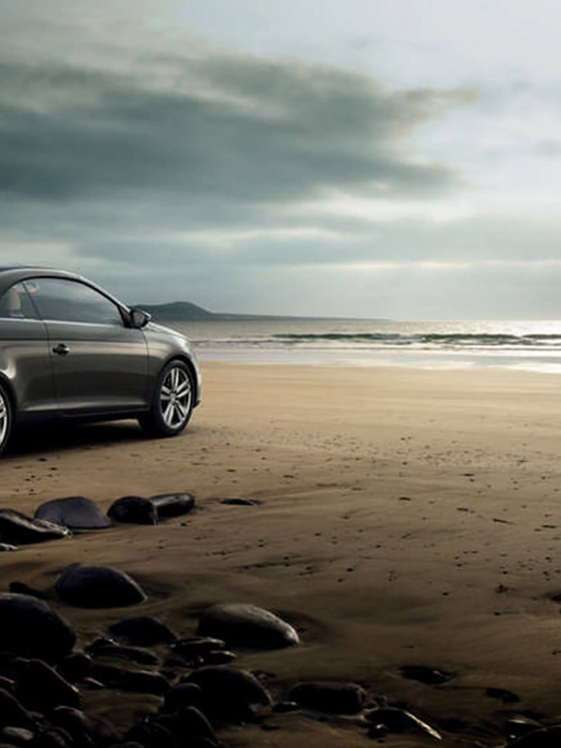 A Volkswagen Eos at the beach.