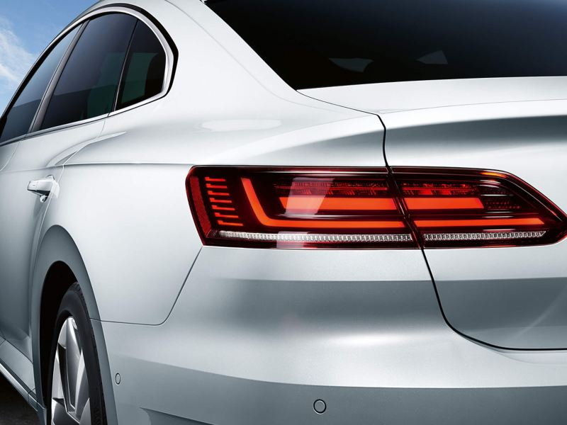 A rear shot of a white Volkswagen Arteon.