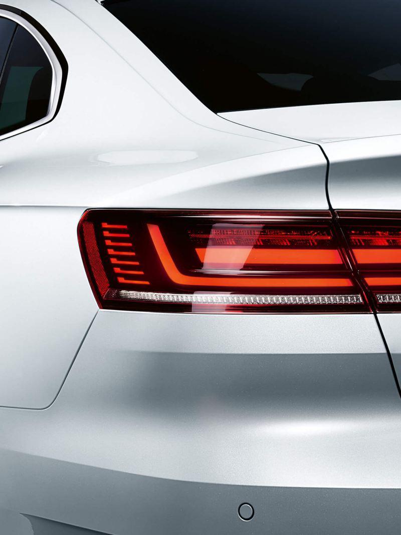A rear shot of a white Volkswagen Arteon.