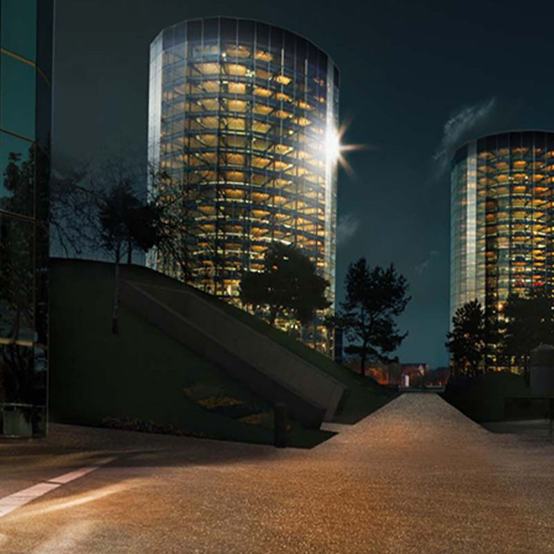 A night shot of two buildings