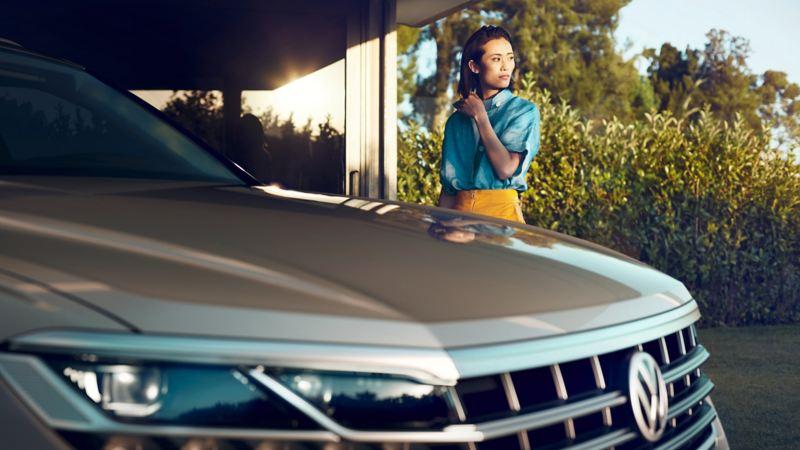 Woman by a car