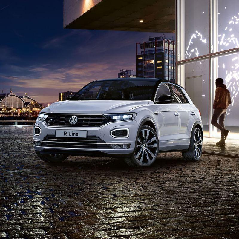 White Volkswagen T-Roc on a dark cobbled road