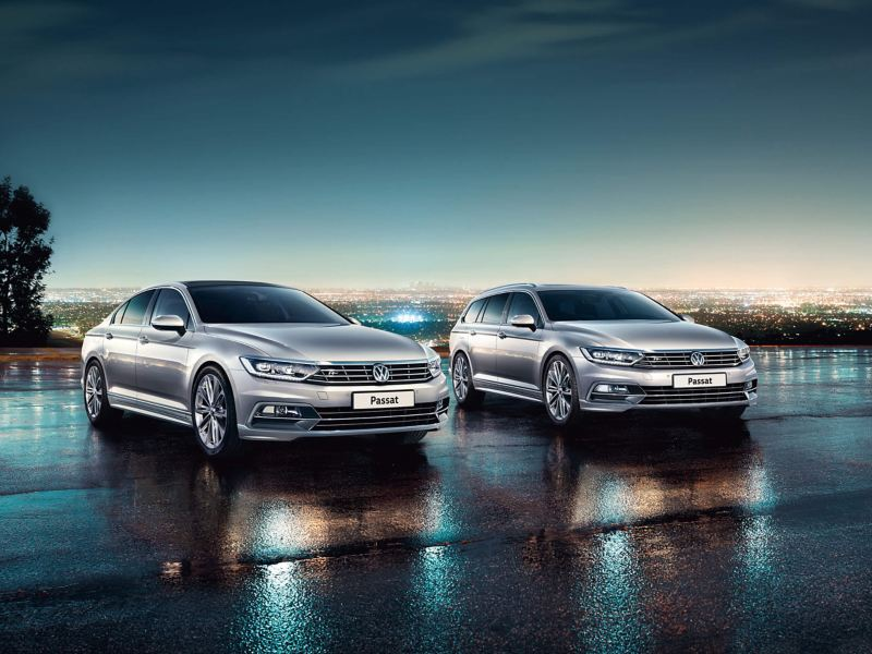 2 Passat's lit up in a car park at night