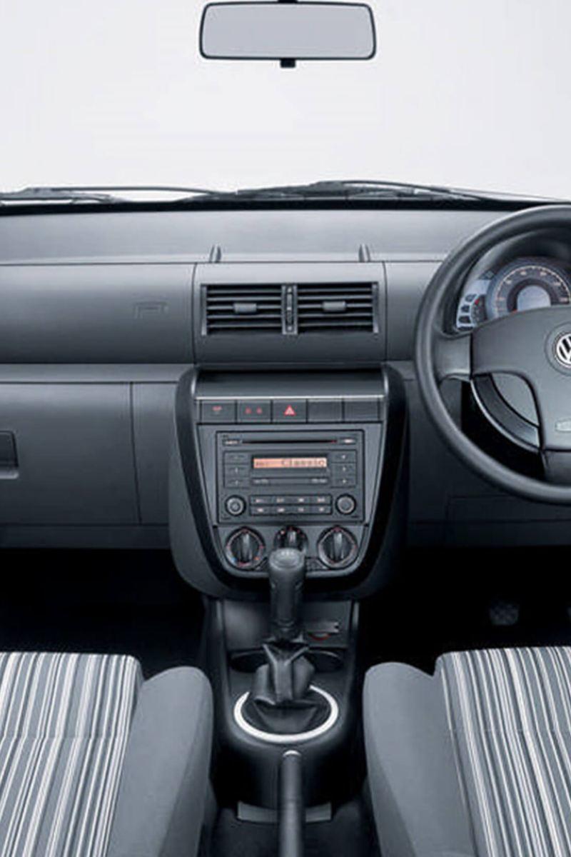 Interior shot of a Volkswagen Fox, steering wheel and dashboard.