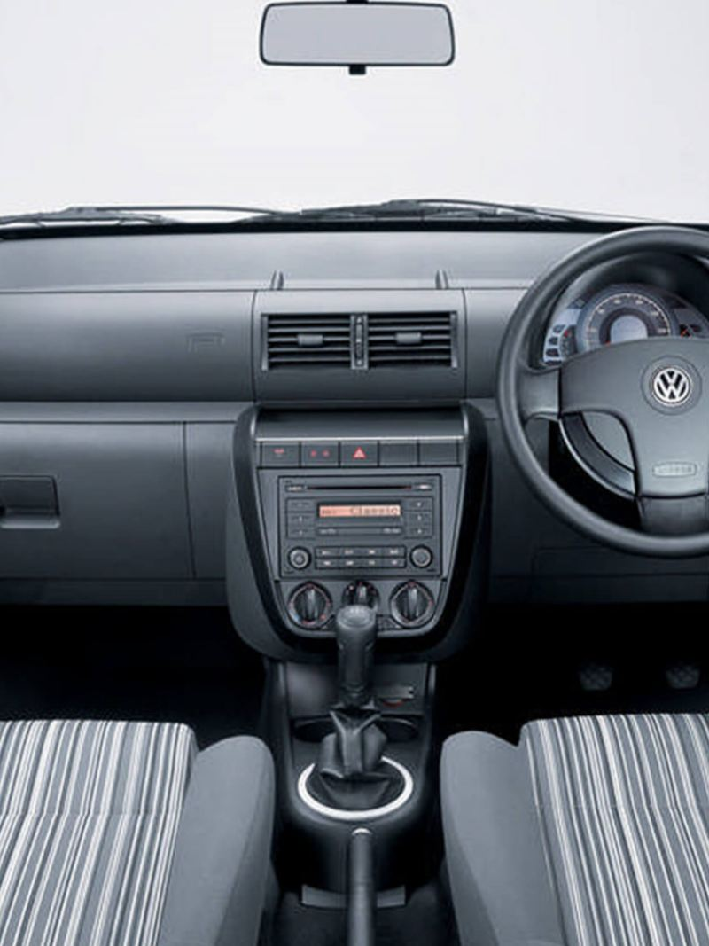 Interior shot of a Volkswagen Fox, steering wheel and dashboard.