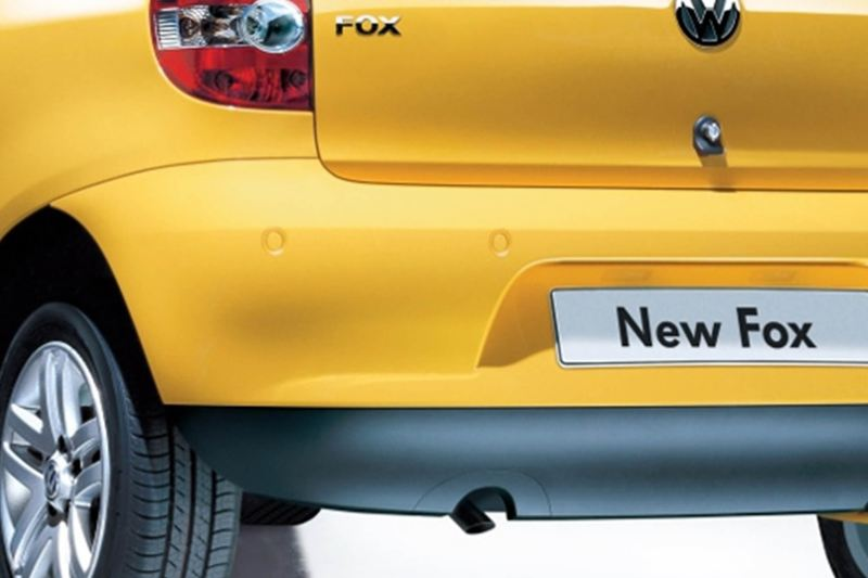 Rear view of a yellow Volkswagen Fox.
