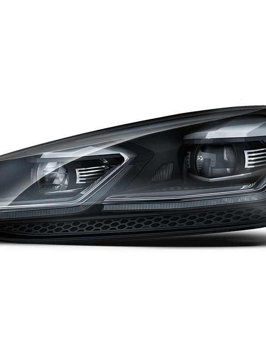 Volkswagen Golf LED headlight, transparent background.