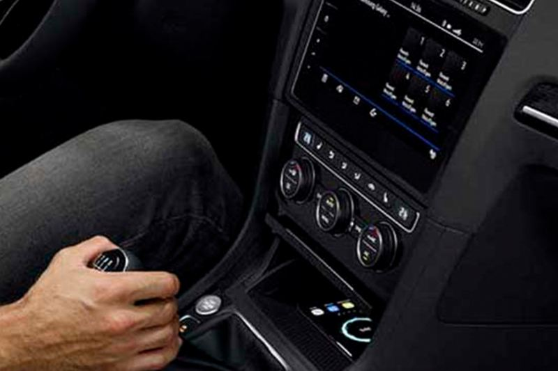 A person changing gears inside their Volkswagen Golf.