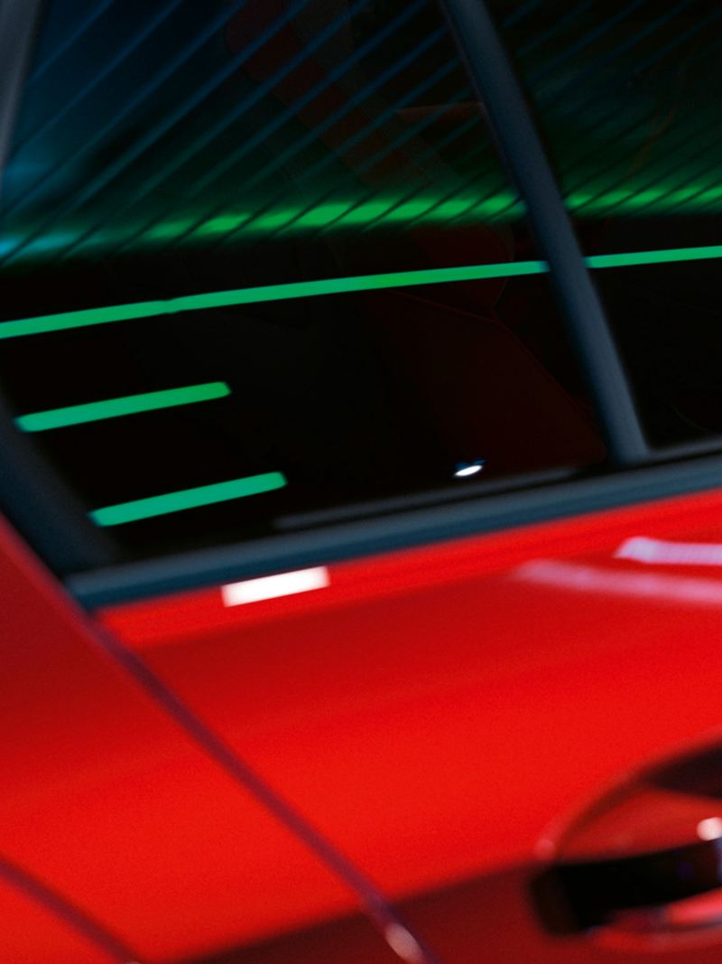 Closeup of the back door of the Golf GTI in red