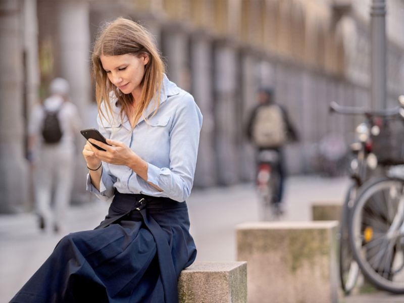 A woman looking at her smartphone