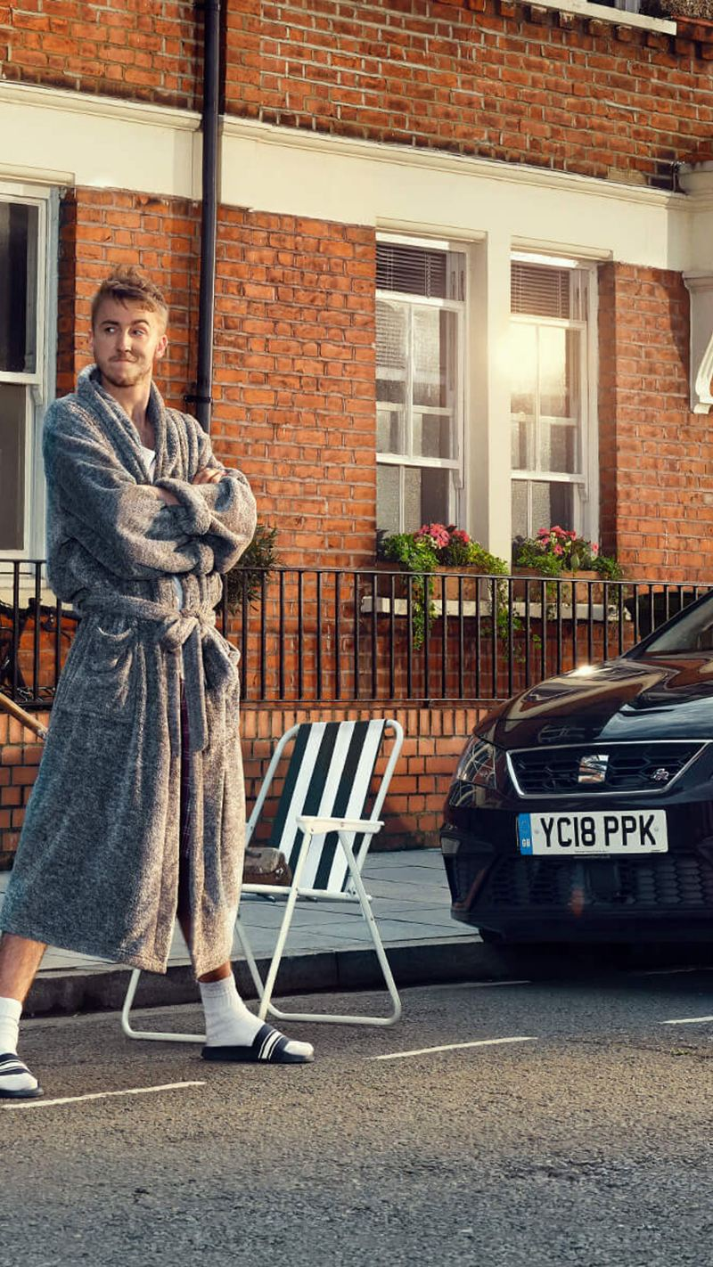 A man stood outside in his bathrobe