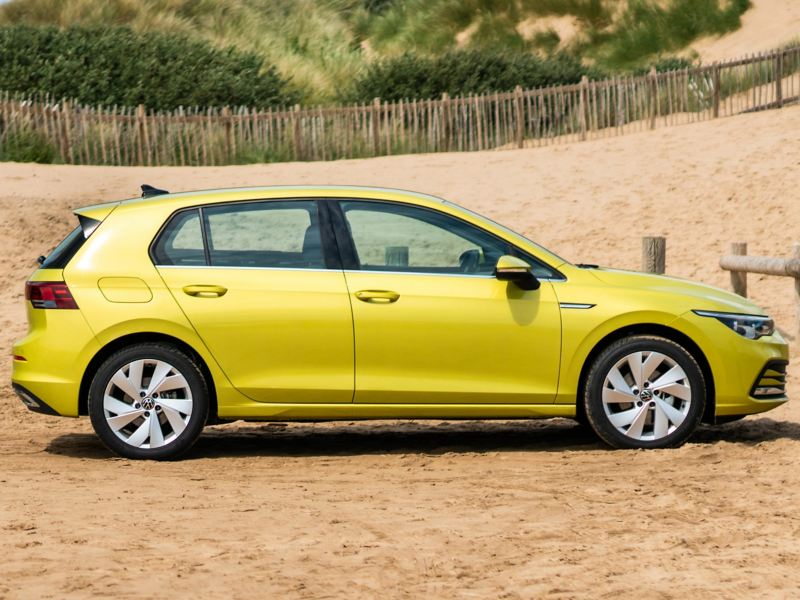 Golf 8 parked on a beach