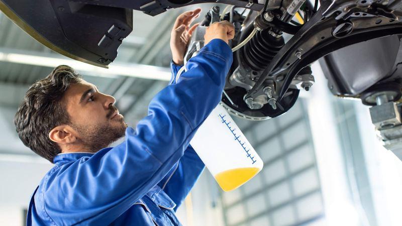VW technician changing van brake disc