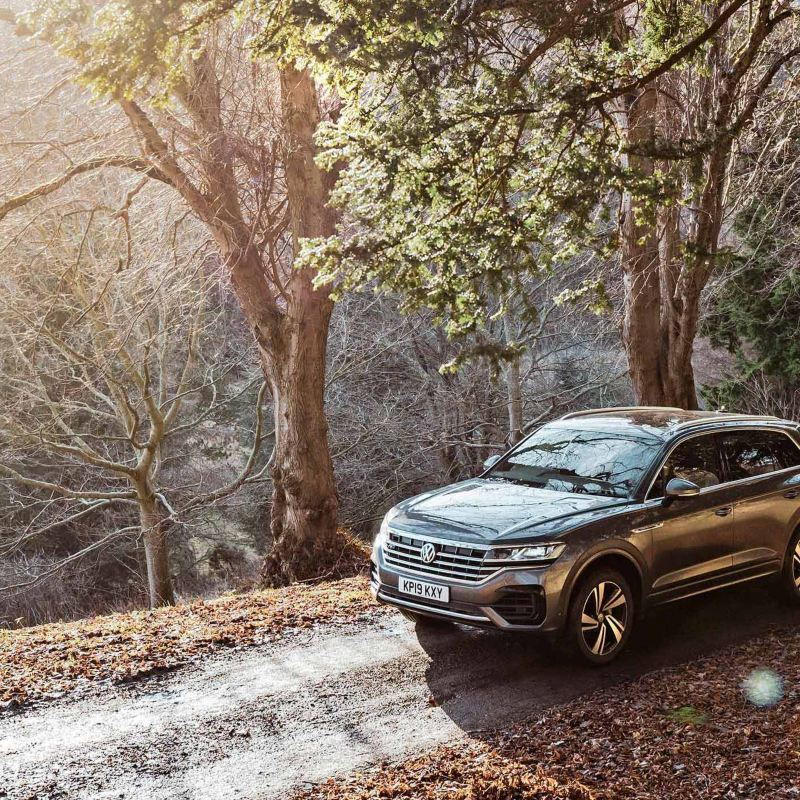 The Volkswagen Touareg driving in the coutryside