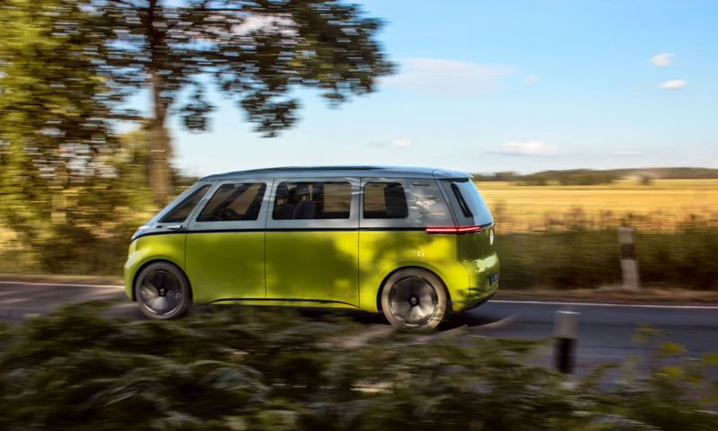 ID. Buzz electric camper van seen from the side on a country road