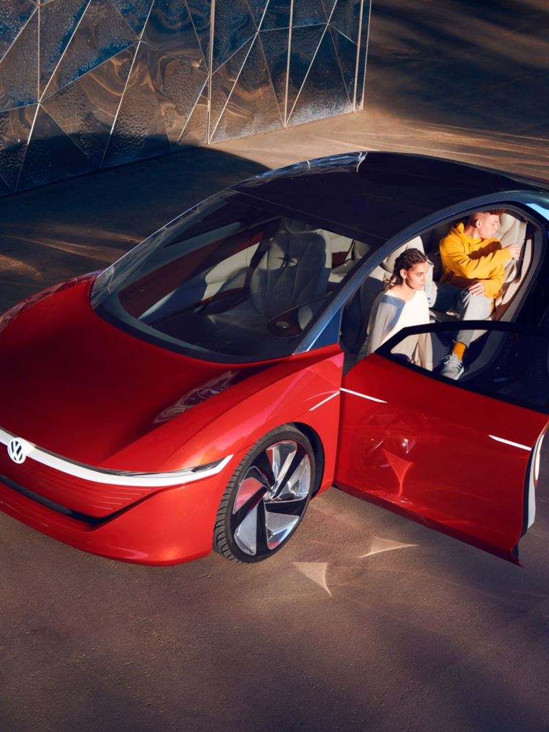 Two people are opening the doors of the ID. Vizzion electric car from Volkswagen