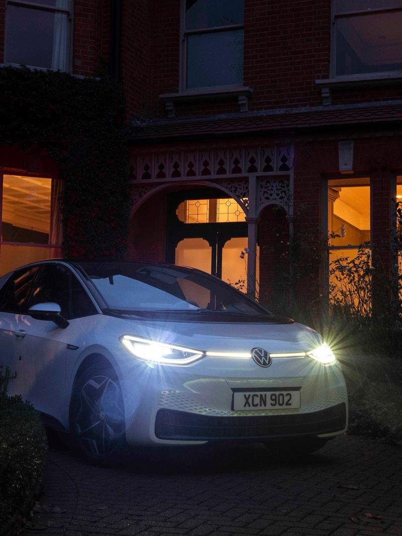 VW ID.3 1ST on a driveway at night